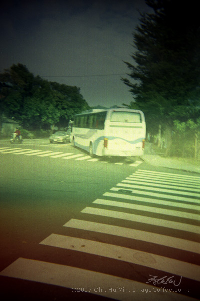 The road, bus and  motor (Toy Camera