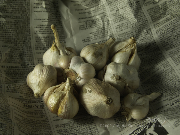 Garlic Bulbs On Newspaper